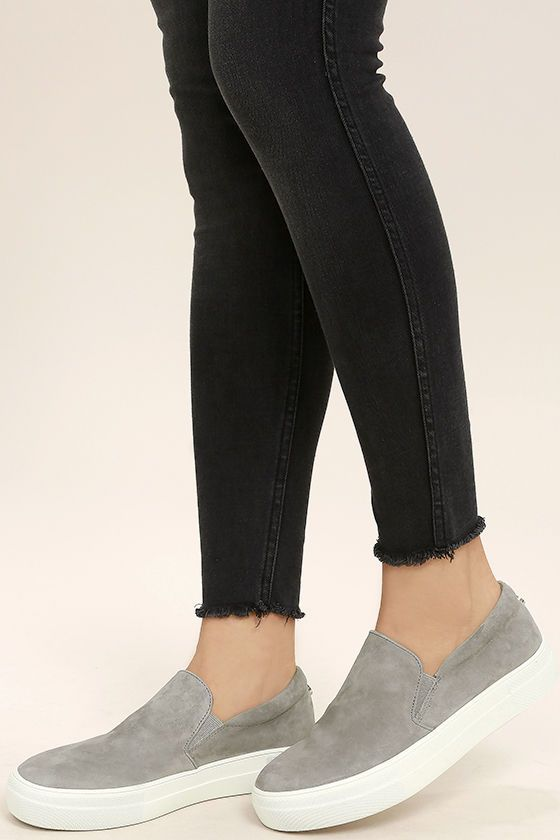 "There's nothing quite like the excitement of stepping out in your new Steve Madden Gills Grey Suede Leather Flatform Sneakers! Perfectly soft genuine suede shapes these cool girl-approved slip-on sneakers. Metal logo tag at the heel. 1.25"" white bumper sole."