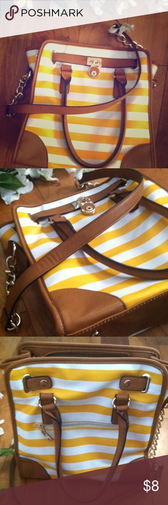 Yellow and White Striped Shoulder Bag Cute white and yellow striped shoulder bag. No brand. It has a flaw on the strap where it sits on your shoulder (see 4th picture). Make me an offer! Bags Shoulder Bags