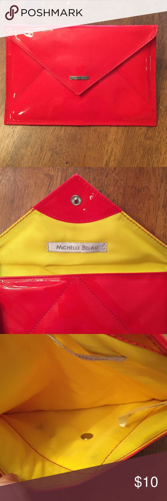 Michelle Belau envelope purse red and yellow Michelle Belau red and yellow envelope purse or cosmetic bag. This bag does have some exterior pen marks and the interior has some make up stains. Michelle Belau Bags Clutches & Wristlets