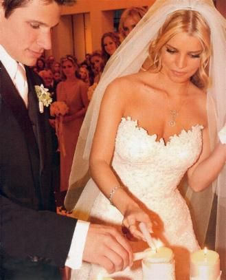 Nick Lachey & Jessica Simpson... I love this and admire her dress and hair for her wedding!
