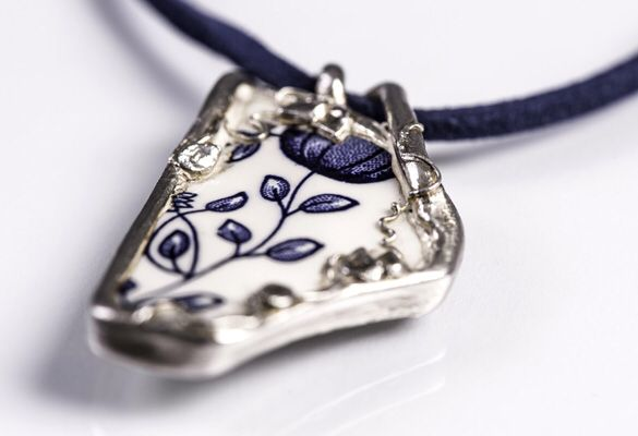 Made by Nuit Nuit China coated in fine silver on a blue suede necklace
