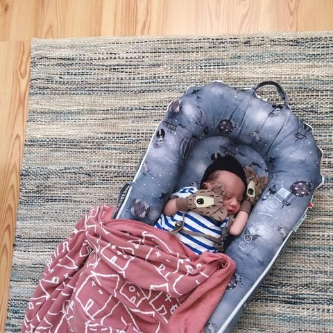"""DockATot Deluxe - Preston, 5 Days Old: DockATot """"reinvents the womb"""" & gives babe a snug, cozy place to catch some major zZzs. Preston takes a few 2-3 hour naps a day & he's slept through the night already - something that our daughter, Bailey, didn't do until after she was 12 months old. I wish we knew about it with her. More sleep for him means more sleep for me. Visit Dockatot.com to buy this must have baby lounger."""