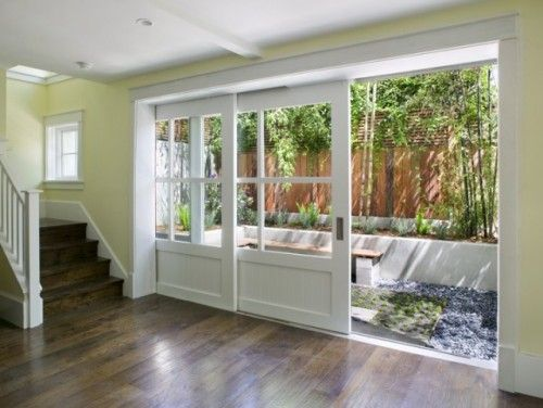 Another take on sliding outdoor doors. I bet they blend in seemlessly when closed. Love it.
