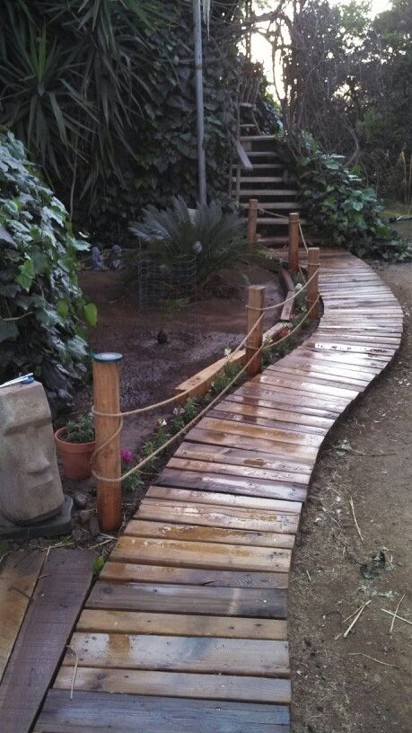 My husband's beautiful new walk way he made out of scrap word from pallets