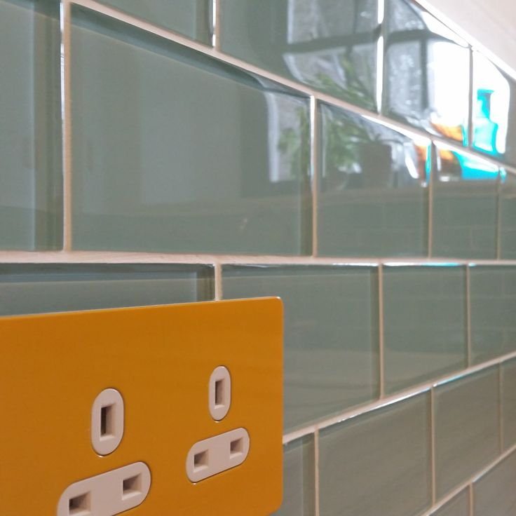 Mellon Yellow unswitched 2 gang UK electrical plug socket on Aqua Marine Turqoise Glass Metro Tiles all from www.too-jazzy.com