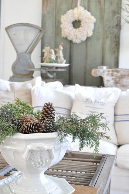 I could use the new white pot I just bought similar to the one pictured and add greens and pine cones