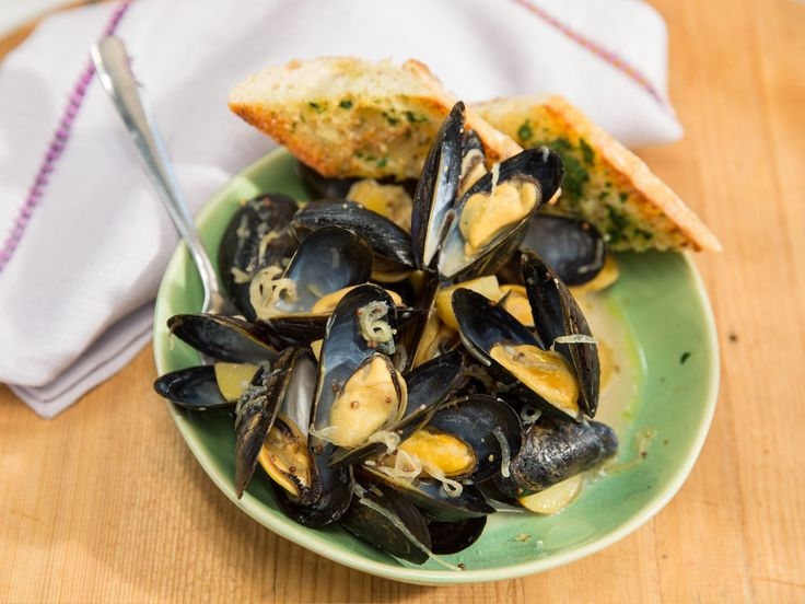 Slow-Cooker Mussels with a Creamy Wheat Beer and German Mustard Sauce recipe from Geoffrey Zakarian via Food Network
