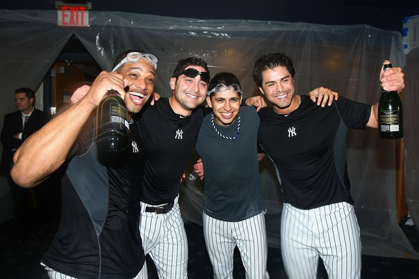 Robinson Cano, Francisco Cervelli, Ramiro Pena, and Sergio Mitre celebrating after the New York Yankees win against the Minnesota Twins during game three of the ALDS, October 9, 2010