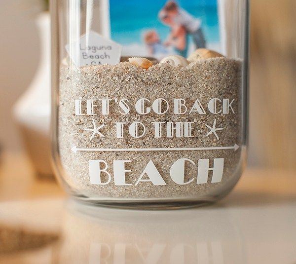 This Beach Memory Jar is a beautiful way to showcase photos of your summer trip.