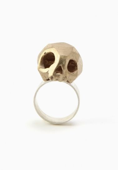 Marmod8 Skull Ring Bronze hand carved skull on a sterling silver band. Steel wool finish. Made by hand in Montreal.  Details:  - Bronze and silver - Size 6 and 9 - Steel wool finish - Handmade in Montreal