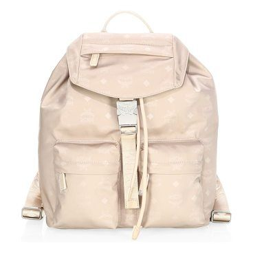 dieter nylon backpack by MCM. Small backpack with allover monogram print. Top handle. Adjustable backpack straps. Drawstring closure. Flap top with buckle closure. Silver hardware. Exterior flap zip pocket. Two exterior zip pockets. Interior zip pocket. Cotton lining... #mcm #bags