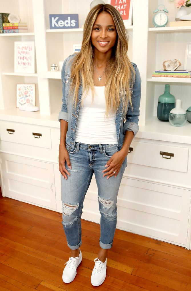 Ciara in a ripped jeans, a denim jacket, white top and Keds sneakers
