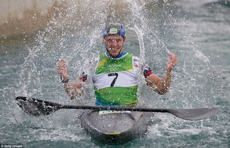 Great Britain's Joe Clarke splashes the water in celebration after he won gold in the men's single kayak