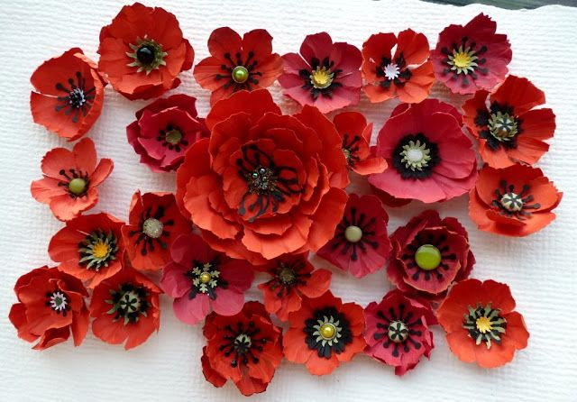 Paper Poppies!  Excellent review of many ways to make paper flowers along with a sample from each method. She uses a variety of paper punches or scissors, and specialty shaping tools, modified cutlery, or tableware straight from the kitchen drawer! Lots of ideas for flower centers and stamens from paper. Use Polish translator, eg. Google. Here's a youtube video w/ a similar idea for making lots of different flowers from a single punch: https://www.youtube.com/watch?v=a8IUKPC8XjE