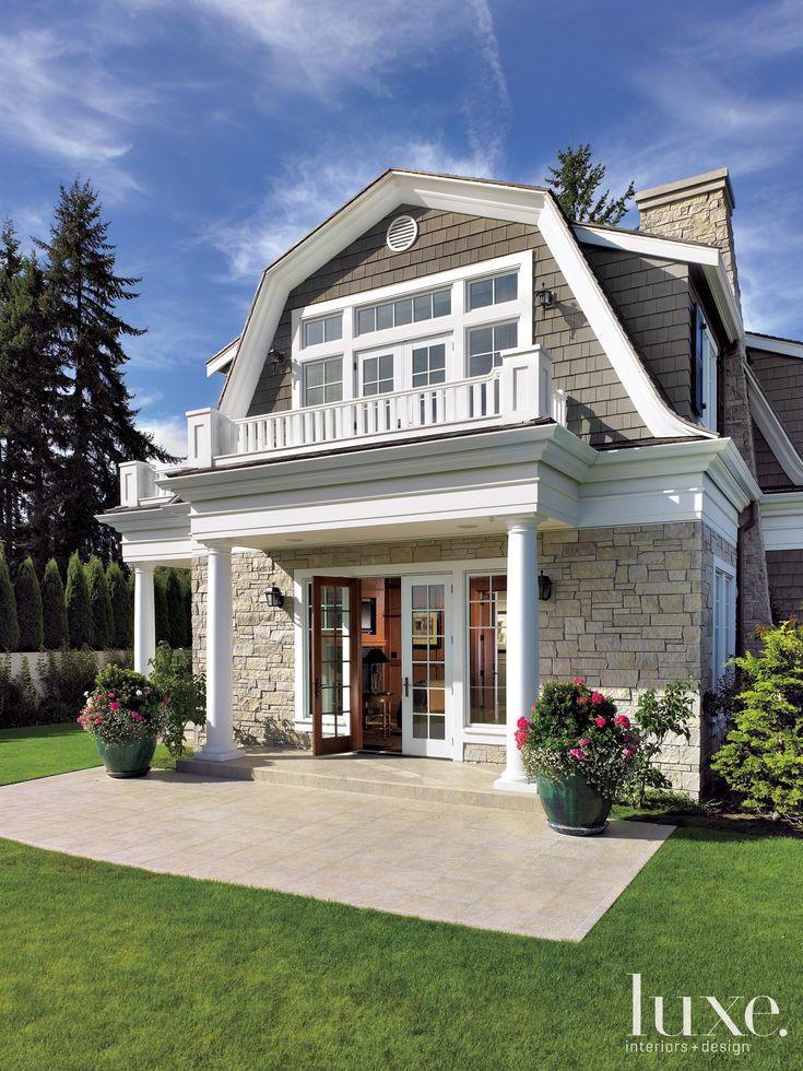 Dutch Colonial porches with exterior front doors and partial stone exterior with cedar-shakes siding.