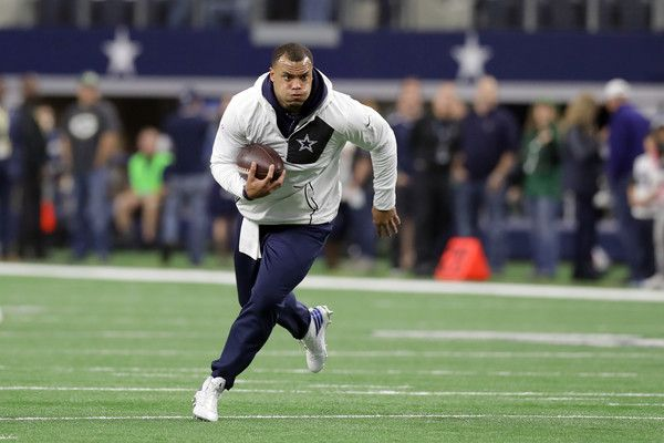Dak Prescott Photos Photos - Dak Prescott #4 of the Dallas Cowboys warms up on the field prior to the NFC Divisional Playoff game against the Green Bay Packers at AT&T Stadium on January 15, 2017 in Arlington, Texas. - Divisional Round - Green Bay Packers v Dallas Cowboys