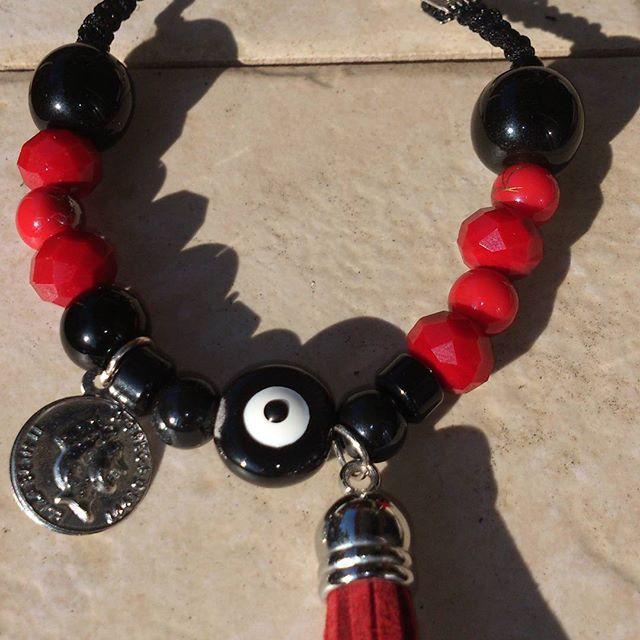 lovely black and red beaded bracelet with eye and tassel
