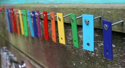 Dismantle an old xylophone and re-hang the keys somewhere on your music wall outside. Viola - instant music!