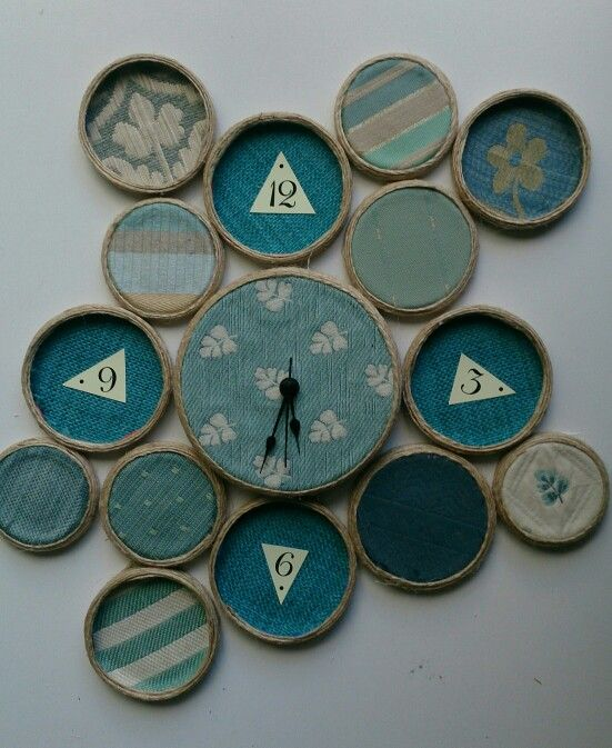 Recycled Wall clock made with jar lids