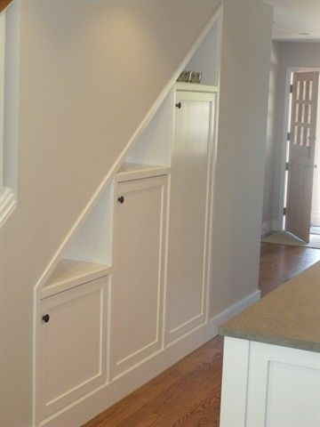 Basement stair storage-- I like the gaps on top for display.