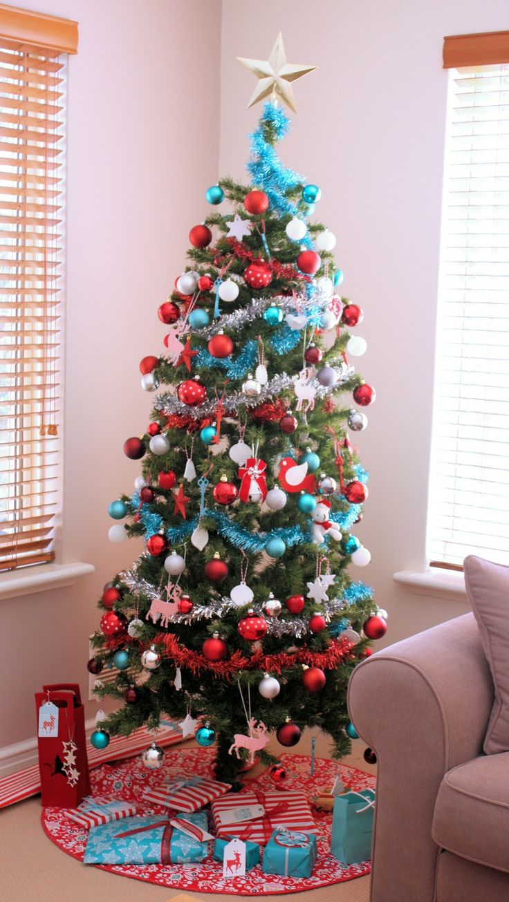It is Beginning to Look a Lot Like Christmas....Hmmm. LOVE the Red & Aqua~Just might have to try that on my tree one year!! : ):