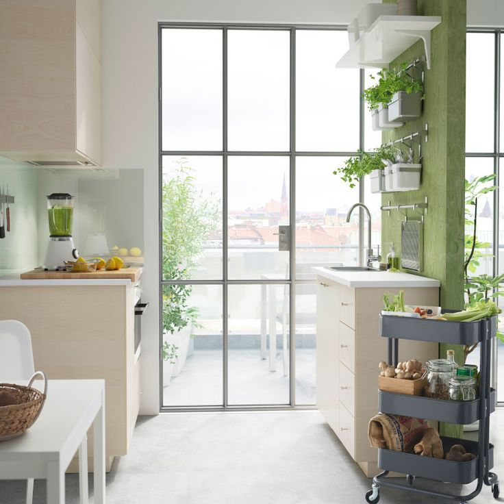 A modern and green small kitchen idea with HAGANÄS fronts in birch veneer