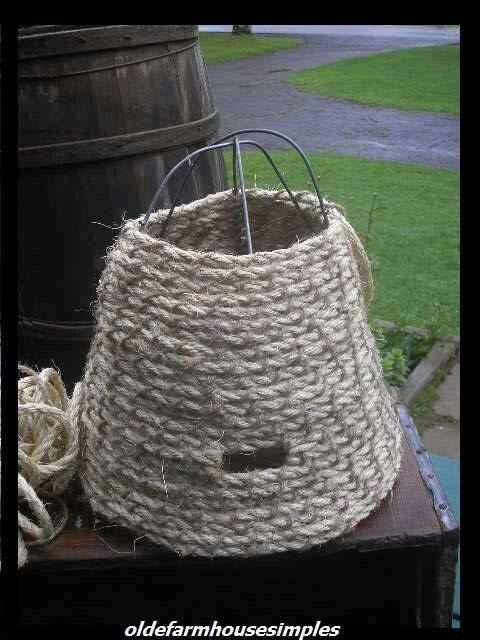 Bee's nest with small tomato cage and rope.
