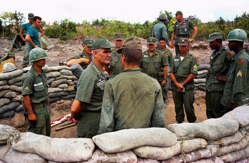 """"""" General William Westmoreland talks with troops of 1st Battalion, 16th Regiment of 2nd Brigade of U.S. 1st [Infantry] Division at their positions near Bien Hoa in Vietnam, 1965. (AP Photo)  """""""
