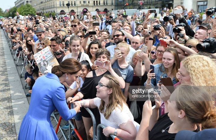 Kate, the Duchess of Cambridge shakes hands with spectators as she visits the Brandenburg Gate in Berlin on July 19, 2017.The British royal couple is on a three-day visit in Germany. / AFP PHOTO / POOL / Gregor Fischer        (Photo credit should read GREGOR FISCHER/AFP/Getty Images)