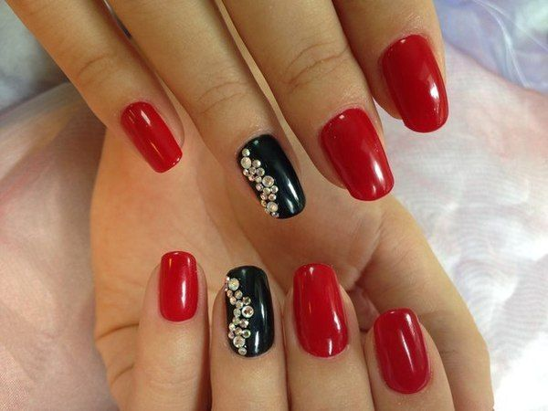 "Red and black – is a surprisingly bold mix, it is considered as one of the most passionate color solutions. When you look at it the style of ""Carmen"" and hot Latin American dances immediately come to mind. Combined with long fingernails these colors look particularly expressive and rhinestones laid out in the shape of a wave dilute the activity of nails a bit, making them more quiet and refined."
