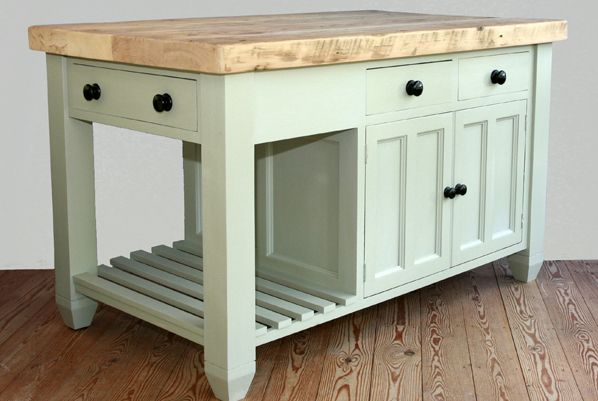 Add a slatted shelf to one end of your kitchen island for storing heavy pots and pans. This light green island will suit most kitchen colour schemes too. http://www.john-willies.com/kitchens/freestanding_islandunits.php