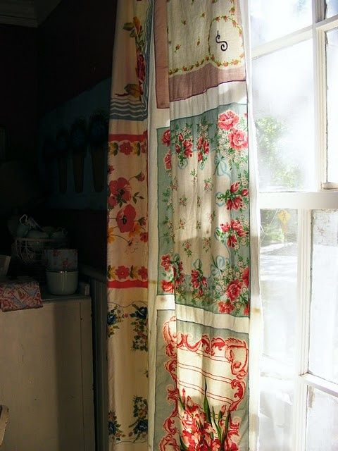 Curtain decorated with vintage hankies.