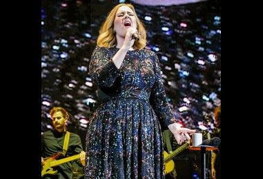 Adele marks end of 107 tour dates with celebratory banner from son