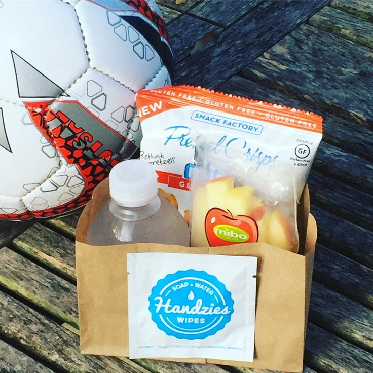 "Check out our snack bags for soccer. I cut down a paper bag and put in small water, pretzel chips and apple fries. I used my favorite ""mom-Mcgyver"" trick and used glue dot to stick on our natural soap and water wipe!  Seriously what problem can't you solve with a glue dot?"