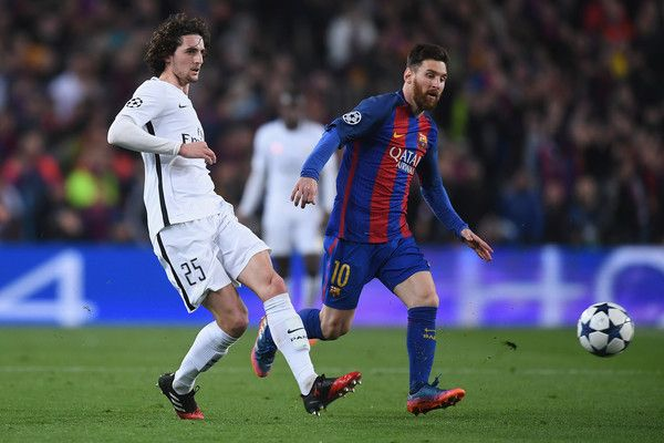 Adrien Rabiot of PSG in action with Lionel Messi during the UEFA Champions League Round of 16 second leg match between FC Barcelona and Paris Saint-Germain at Camp Nou on March 8, 2017 in Barcelona, Catalonia.