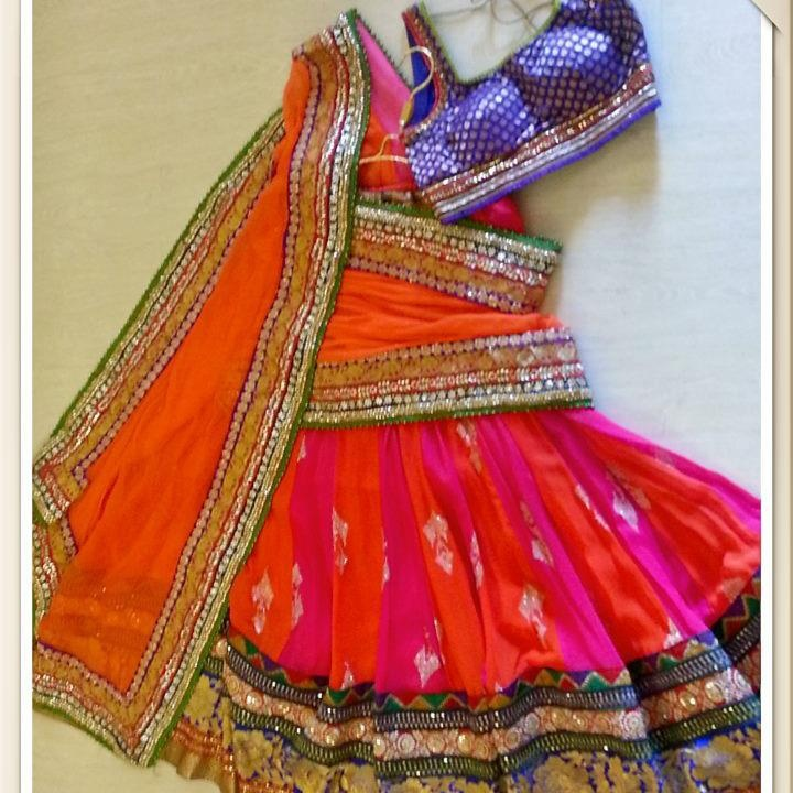 Playing with the concept of three - Lehenga in Orange and Pink, Heavy Gota border and Blue Choli