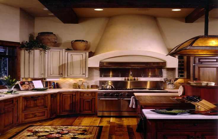 Throwback Thursday to one of our favorite projects. We love the custom range hood in this spectacular kitchen. For, more of our projects, visit our website. http://ciaointeriors.com/portfolio/