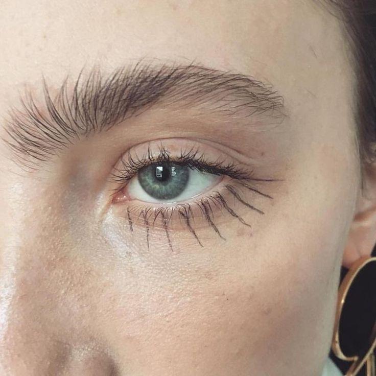 drawn on eyelashes, natural brows