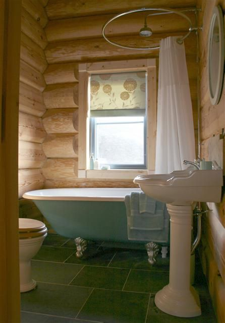 Roll top bath with overhead shower. Pretty and works in a small space.
