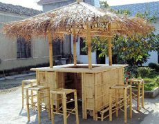 """Bamboo Tiki Bar-Our bamboo Tiki Bars feature plenty of storage and hanging space. The counter width is 18"""" x 72"""" on the 6 ft unit and 24"""" x 96"""" on the 8 ft unit in a square layout respectively. Counter height is 44"""" on both of these units. Overall structure dimensions are 11' high, 9' wide for the larger unit and 8' for the smaller unit. Two counters with cabinet doors open to two-tier shelf storage below the counter with two open shelves on the opposite side. Choice of tropical grass thatch…"""