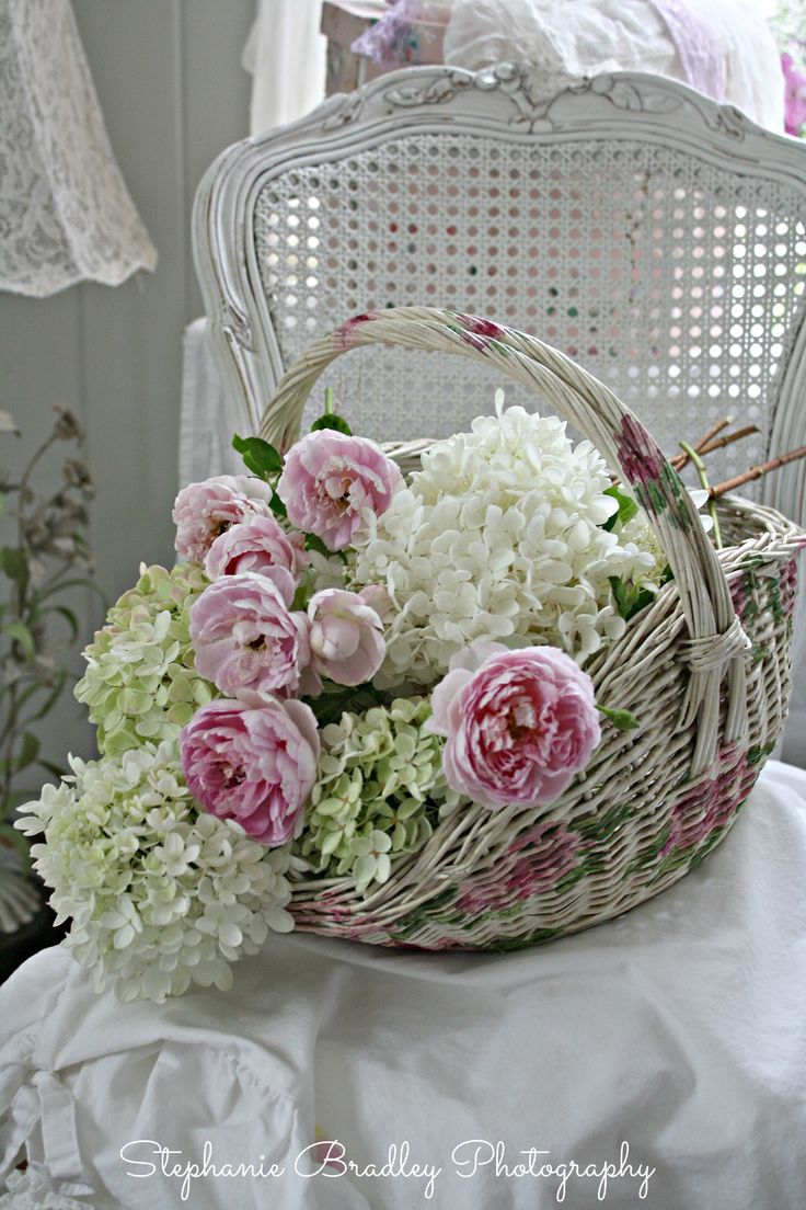 """""""Darcy chair with a basket of garden hydrangeas and David Austin roses from my garden."""""""