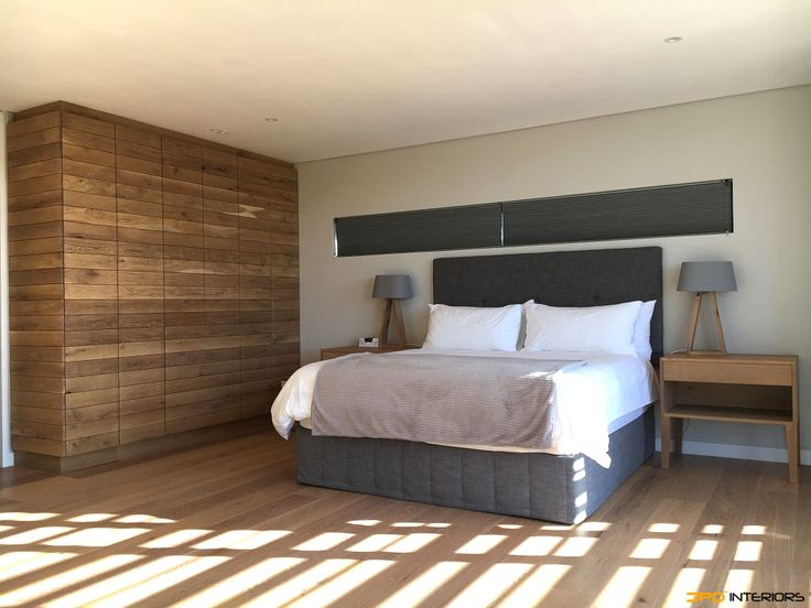 Second bedroom with solid French oak with continuous grain across all doors and drawer fronts. Drawers with Blum undermount soft close with touch control.