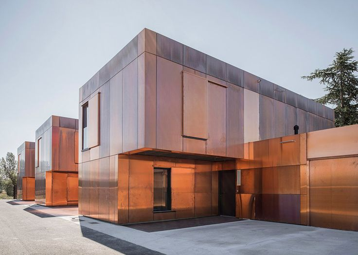 French middle school clad with tarnished copper panels.