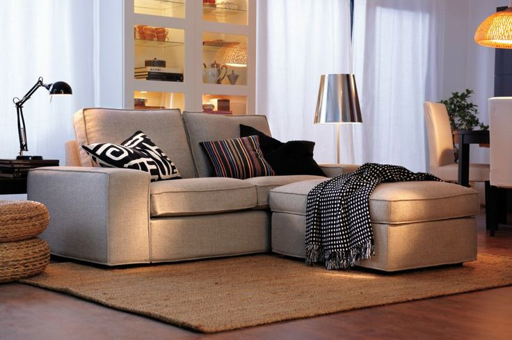 Ikea Loveseat with chaise lounger.... not a bad idea   I want the throw rug