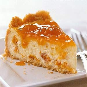 We made classic cheesecake an even sweeter dessert by putting apricots inside and an apricot glaze on top.