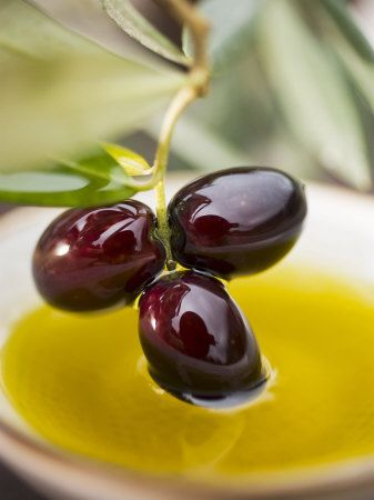 Dipping Olive Sprig with Black Olives in Olive Oil.....By Engineersparksfrom Staffordshire, England