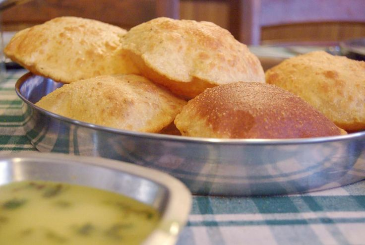 Poori is a crispy, golden, deep-fried Indian bread that you can serve with any dish and your favorite pickle. See how to make it with this recipe.