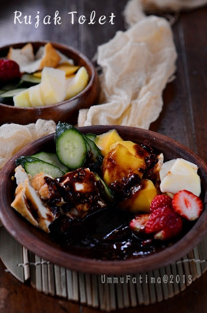 Rujak tolet Indonesian fruit with hot sweet brown sugar sauce