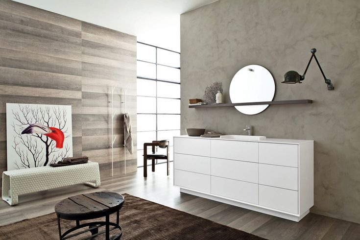 Floor standing composition in White opaque lacquer with removable recessed plinth provide additional storage space. Lacquered shelf bathroom cabinet shown in opaque Mouse lacquer with recess for the round mirror add style and functionality #SnaideroUSA