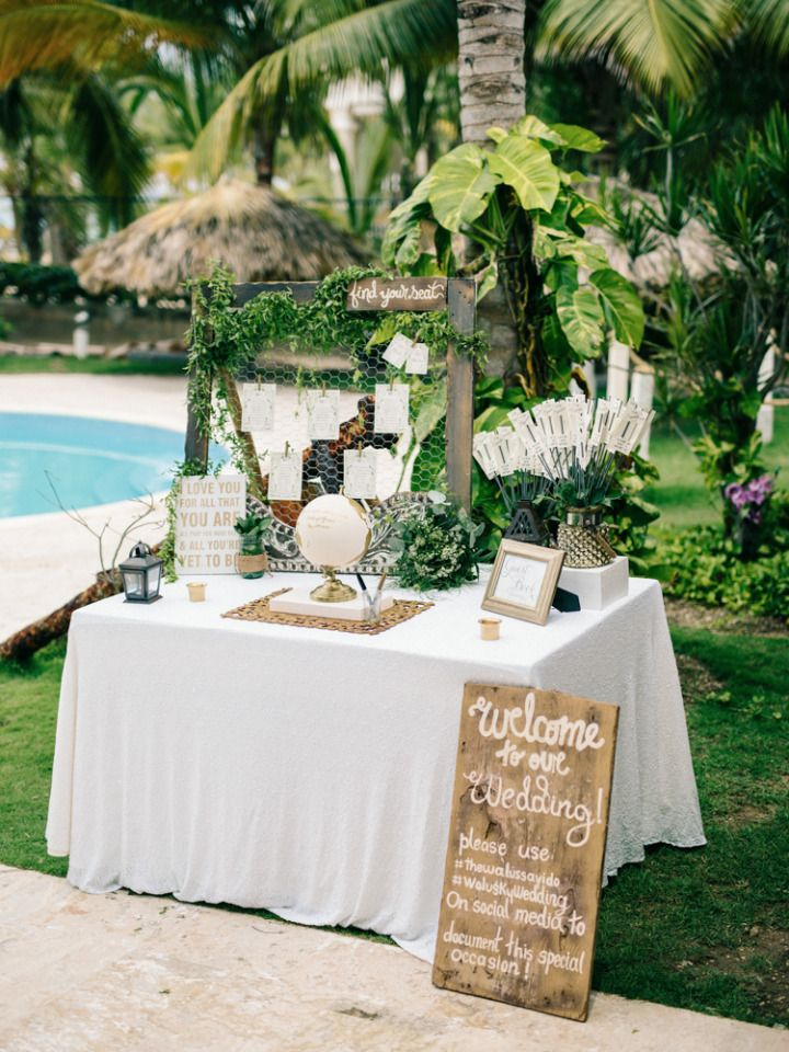 green and gold wedding welcome table